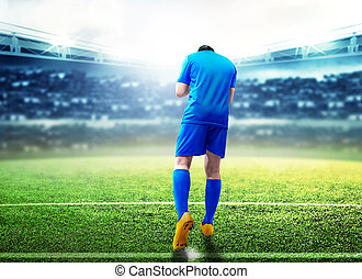Rear view of asian football player man celebrate his goal