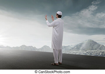 Rear view of asian muslim man praying