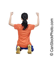 Rear view of asian soccer player woman with happy celebration