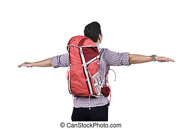Rear view of asian traveler with backpack