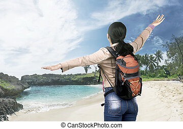 Rear view of asian traveler woman with backpack enjoying the view