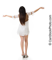Rear view of Asian woman with white short dress feel free