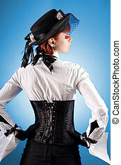 Rear view of attractive girl in Victorian style clothes