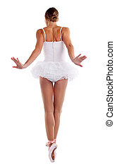 Rear view of ballerina dancing on pointes