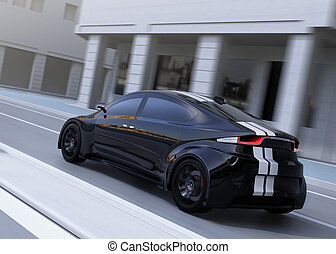 Rear view of black sports car driving on the street