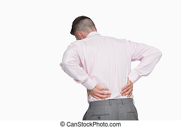 Rear view of business man with back pain
