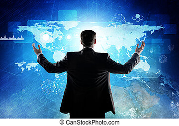 Rear view of businessman looking at digital screen