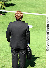 rear view of businessman on hill
