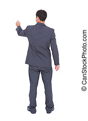 Rear view of businessman using a marker