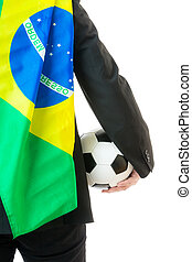 Rear view of businessman with soccer ball and Brazil flag