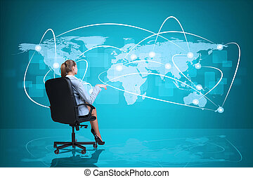 Rear view of businesswoman sitting in chair