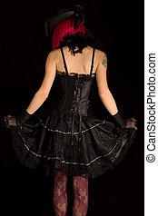 Rear view of cabaret girl in black corset dress