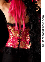 Rear view of cabaret girl in pink corset