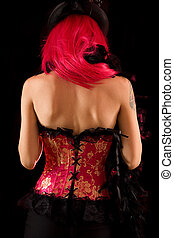 Rear view of cabaret girl in pink corset and hat