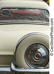 Rear View of Classic Car - A view of a cream colored classic...
