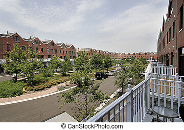 Rear view of condominium complex with courtyard