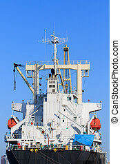 rear view of container ship bridge against clear blue sky