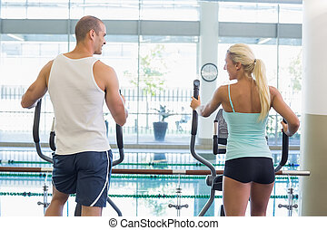 Rear view of couple at gym