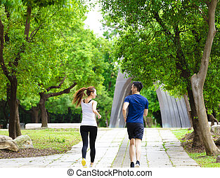 rear view of Couple jogging and running  in nature