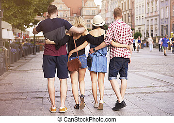 Rear view of couples walking on the streets