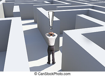 Rear view of desperate businessman standing in maze being...