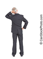 Rear view of doubtful mature businessman