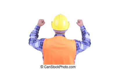 Rear view of happy bearded Persian man construction worker...