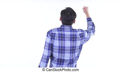 Rear view of happy young Asian hipster man with fists raised...