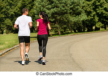 Rear view of jogging caucasian couple - Rear view of jogging...