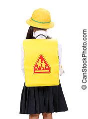 Rear view of little Asian schoolgirl