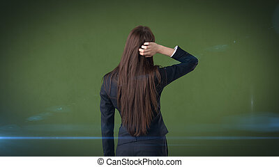 Rear view of long dark hair beauty thinking or looking on her right side.