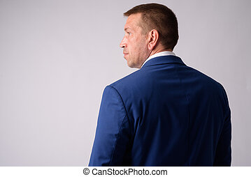 Rear view of macho mature businessman in suit