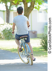 Rear view of male cyclist