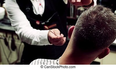 Rear view of man client visiting haidresser and hairstylist...