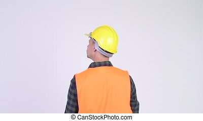 Rear view of man construction worker pointing finger