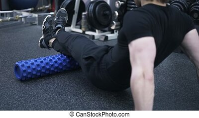 Rear view of man on a fitness roll, close up