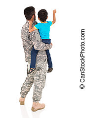 rear view of military father and his son pointing at empty...