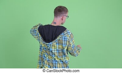 Rear view of nerd man touching something - Studio shot of...