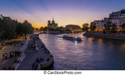 Rear view of Notre Dame De Paris cathedral day to night...