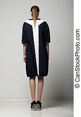 Rear View of of Trendy Chichi Woman in White-Black Contrast Raincoat. Vogue