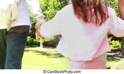 Rear view of parents playing with their daughter