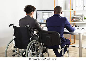 Physically Impaired Businessman With His Partner Working