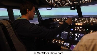 Rear view of pilot operating jet controls - Rear view of...