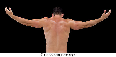 Rear view of shirtless muscular man with arms raised - Rear ...