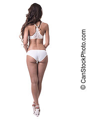 Rear view of slim girl in white erotic lingerie