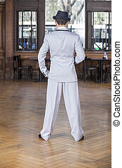 Rear View Of Tango Dancer In Restaurant