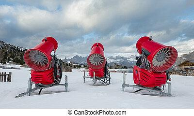 Rear view of three snow cannons in alpine ski resort