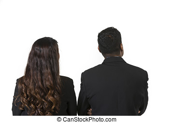 Rear view of two indian business people.