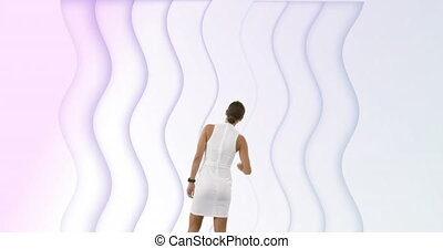 Animation of rear view of woman looking at rows of white waves pulsating in seamless loop in the background. Movement and abstract concept digital composite.