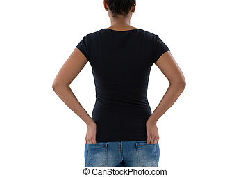 Rear view of woman with hands in pockets